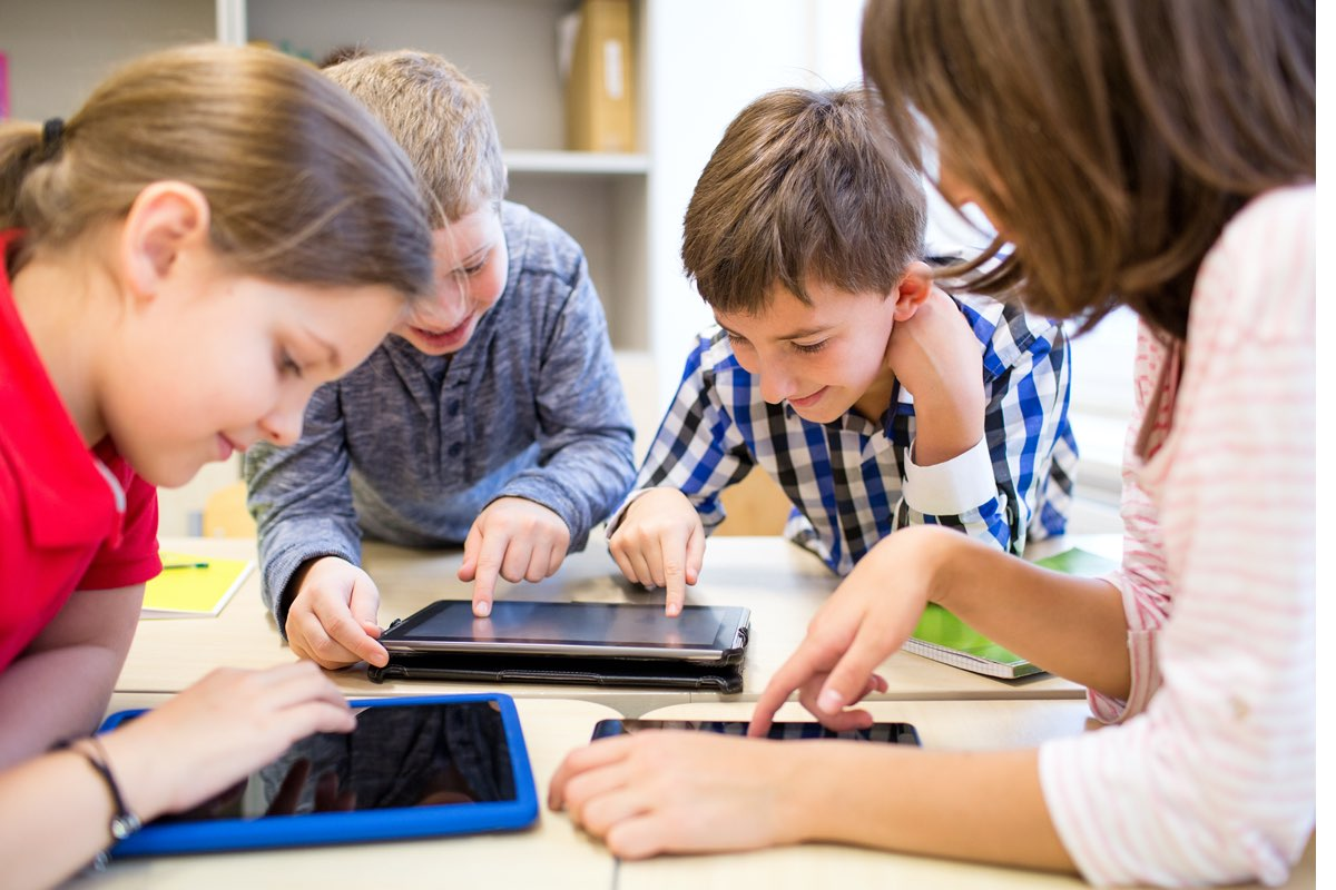 group-students-tablets-collaborating_shutterstock_234587068